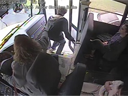 School bus video shows Samantha Call, a driver with Norwich (N.Y.) City School District, grabbing the student by his jacket as a vehicle speeds past the stopped bus. Screenshot from bus video posted on the district's Facebook page.