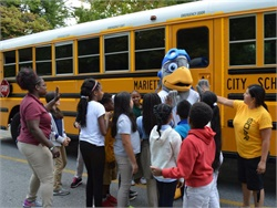 At Marietta (Ga.) City Schools, students going through the SOAR school bus safety program meet the district's SOAR eagle mascot.