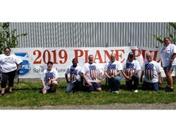 "Hudson Bus Lines worked with the Travis Mills Foundation on a ""Plane Pull"" event to raise $100,00 for a retreat for veterans and their families. Shown here are some members of the Hudson Bus Lines team."