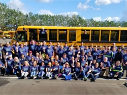 "STI's ""Bully-Free Buses"" campaign starts with Blue Shirt Day. Shown here are employees at Cascade Student Transportation in Battle Ground, Washington, a member of the STI family of companies, wearing blue shirts in a show of solidarity against bullying."