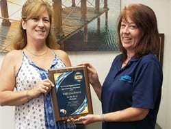 Vikki Boyce Czechowicz (left) was honored with a Heroism Award plaque, presented by Tonya Phillips, a manager for STA, for evacuating students from her bus right before it caught fire. Photo courtesy Student Transportation of America