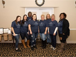 Student Transportation of America (STA) raised nearly $10,000 for the STI Cares Foundation, the school bus company's philanthropic arm, and a local cancer support charity. Shown here are some of the STA employees who volunteered at the event.