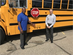 Hopkins (Minn.) Public Schools is testing Safe Fleet's Predictive Stop-Arm. Shown here are Derrick Agate, the district's transportation supervisor (left), and Tom Brodsky, vice president of the advanced technology group at Safe Fleet.