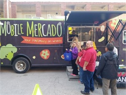 "During a health fair, San Antonio ISD transportation staff stepped aboard the ""Mobile Mercado,"" a grocery store and demonstration kitchen on wheels."