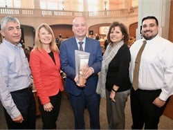 San Antonio (Texas) ISD won an award from the city for its Clean Green Yellow School Bus Machines program. Shown here are district staff members with Nathan Graf, senior executive director of transportation, center.