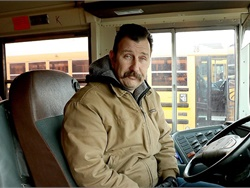 School bus driver John Lunceford noticed a boy waiting for the bus in freezing temperatures with no hat or gloves, so he gave him his gloves. He then bought hats and gloves for other students in need on his route. Photo courtesy Kennewick School District