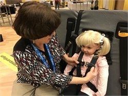 The National Safety Council is calling for volunteers to help make updates to training curriculum on pre-K child passenger restraint systems. Shown here is NHTSA training of proper child securement in an integrated five-point seat.