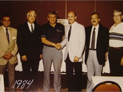 Six past state directors are seen here in 1984 at the Southeastern States Pupil Transportation Conference. From left: Norfleet Gardner of North Carolina, Buster Bynum of Virginia, an unidentified state director, another unidentified state director, Larry McEntire of Florida, and Paul Stewart of West Virginia.