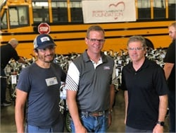 """Bobby Labonte (shown right, with """"Fast"""" Freddie Rodriguez and Caley Edgerly, center) visits Thomas Built Buses for Bike Build Day, where bicycles were assembled and later donated to local High Point, North Carolina, nonprofits."""