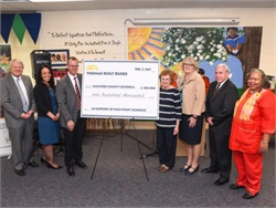 Last year, Thomas Built Buses President Caley Edgerly (third from left) presented a $100,000 pledge from the company to officials at Guilford County Schools.