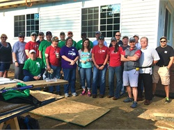 Thomas Built Buses employees helped build Habitat for Humanity's 100th and 101st homes in the area to celebrate 100 years in business.
