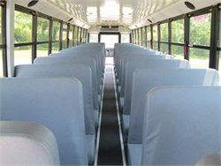 A California bill would require school buses to have a device designed to prompt drivers to walk to the back to check for students. Photo by Bill McChesney