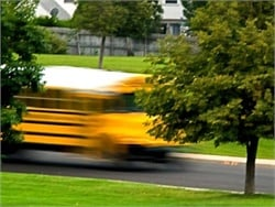 A proposed rulemaking would require new commercial vehicles, including school buses, with a GVWR of more than 26,000 pounds to be equipped with devices that cap their speed. Photo by John Horton