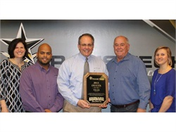 Leonard Bus Sales won Trans Tech's 2015 Dealer of the Year award. Pictured is Stacey Bruce (left), Alicia Mastropietro (right), and Frank Continetti (center) of Leonard Bus Sales and Erickson Lopez (second from left) and John Phraner of Trans Tech.