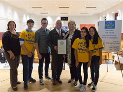 New York City Council Member Paul Vallone presented Vallo Transportation President Linda DeSabato with a proclamation for the company's work on bullying awareness. Photo courtesy Joe Connor Photography