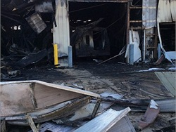 Warsaw (Ind.) Community Schools' bus shop caught on fire on the evening of Jan. 7. The fire destroyed three school buses, a service truck and several supplies. Photo by John Ryan