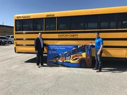 The Lion Electric Co. is delivering 13 electric school buses to Ontario operators in a pilot program. Shown here are Lion staff members with the bus for Switzer-Carty Transportation.