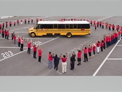 The district's transportation team showcased their creativity by forming a heart around the vehicle they love most: a school bus. Photo courtesy Orange County Public Schools