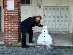 On Dec. 8, San Antonio, Texas, got about 2 inches of snow — the most in more than 30 years for the home of the Alamo. Here, Carmen Hughes, a transportation payroll manager for San Antonio ISD, shows off a rare (and probably short-lived) San Antonio snowman.