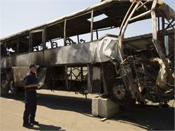 Highway Safety Investigator Robert Accetta is part of the go-team that the NTSB sent to the accident site. Here, he documents the damaged motorcoach.Photo courtesy NTSB