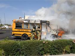 PHOTOS: Firefighters Battle School Bus Blaze
