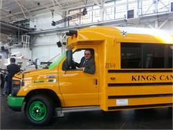 Former director of transportation John Clements will serve as an advisor for Motiv on a part-time basis. He's pictured in the SSTe all-electric school bus developed by Motiv and Trans Tech Bus.