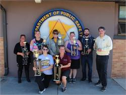 Top contestants in the 2015 Minnesota School Bus Roadeo display their trophies.
