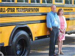 All-Star Transportation will purchase school bus contractor Worhunsky Corp. Pictured are All-Star President John Dufour and Operations Manager Leslie Sheldon.
