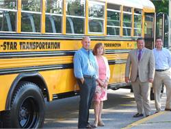 Shown here with one of All-Star Transportation's propane buses, from left to right: John Dufour, president, All-Star Transportation; Leslie Sheldon, operations manager, All-Star Transportation; Connecticut State Rep. John Case; and Ryan Bingham, former Torrington mayor. Photo courtesy of All-Star Transportation.
