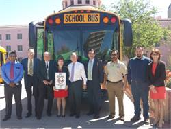 The event featured two new alternative-fuel Thomas Built buses to celebrate grant awards for school bus upfits for the districts. EPA, Clean Cities, local government and school district officials stand next to one of the buses at the unveiling.