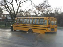 The rear wheels of a Baltimore County Public Schools bus dropped into a sinkhole after a water main broke overnight. Photo courtesy Baltimore County Police Department