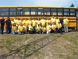 As part of their campaign, Maine School Administrative District #61 transportation staff wear yellow T-shirts that declare the district a bully-free zone.