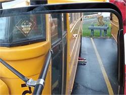 """""""Can You See Me"""" arms can be placed around buses to encourage drivers to look closely for, as an example, a child picking up a dropped item."""