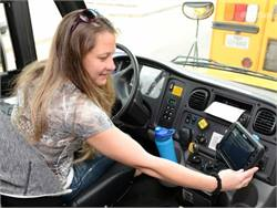 Erika Davis, a driver for Cypress-Fairbanks Independent School District, uses the newly installed GPS transmitter on her bus.