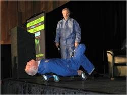 NAPT awards banquet host Mike Martin, who is the association's executive director, got the evening off to an amusing start by hosting lying down. He's pictured with NAPT communications consultant Barry McCahill. They're dressed in jumpsuits similar to those worn by 1980s crash test dummies Vince and Larry. The campaign was developed by McCahill when he worked for NHTSA.