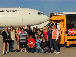 Durham School Services donated 10 buses and drivers to transport participants of the Special Olympics of Illinois' annual Torch Run Plane Pull.