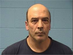 Keith Patzlaff, 55, was arrested after allegedly trying to force open the doors of a school bus and throwing objects at it.
