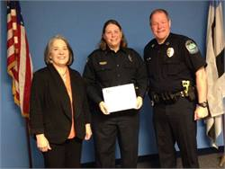Knoxville Mayor Madeline Rogero (left) and Police Chief David Rausch named Trish Ward the December Officer of the Month.