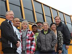 These Round Rock (Texas) Independent School District school bus drivers and Transportation Director Fritz Klabunde, shown left, braved icy weather conditions to pick up students and staff who were stranded on a weekend in the Dallas-Fort Worth area by the weather.