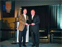 Indiana state director Pete Baxter (left) accepts the SBF award from Publisher Frank Di Giacomo.