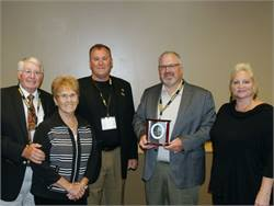 Tom Hey (second from right) won MSBOA's Jim DeVeau Award. Pictured with him, from left, are Marv Hey, Jan Hey, Jim Hey and Jennifer Hey.