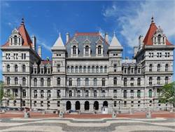 NYAPT is calling on the New York Legislature to ensure full funding for transportation aid, among other recommendations. Pictured is the State Capitol. CC-BY-SA-3.0/Matt H. Wade
