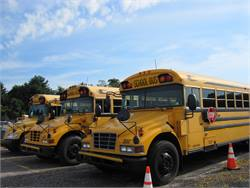 On the Go Kids Inc. was still able to deliver service the morning after its offices were destroyed by a fire. Shown here are some of the buses from the contractor's fleet. No buses were damaged, since they were parked in a different location.