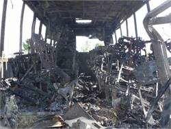 NTSB's docket on a fiery 2014 motorcoach-truck crash in California includes this photo of the charred interior of the motorcoach, which was transporting high school students.