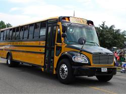 Independent School District 15 ordered 38 propane-powered Thomas Built Saf-T-Liner C2 school buses after seeing several benefits in testing three of the buses. One of the new buses, shown here, was featured in the St. Francis, Minnesota, Pioneer Days parade in June.