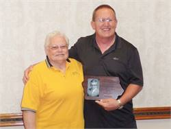 Paul Heide received Iowa's top pupil transportation honor, the Tom Horn Memorial Award. He is seen here with Nancy Horn, wife of the late Tom Horn.