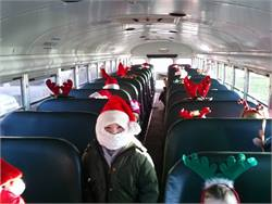 "Jan Powell, a bus driver for Liberty-Benton Local Schools in Ohio, took this photo of the students on her school bus. When asked about the photo, she said, ""I looked in my mirror and what did appear? A miniature Santa and 28 reindeer!"""