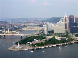 Pittsburgh Public Schools collaborated with its 19 transportation providers to form a new agreement, which doesn't increase walking distances for students. Pictured is downtown Pittsburgh. Photo by Bobak Ha'Eri
