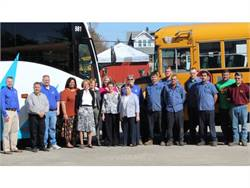 Under new owner Aaron Haid (far left), Klug Bus Service is now Queen City Transportation, offering charter and school bus service under one umbrella.