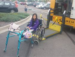 School districts such as Adams County (Colo.) School District 14 have adopted software programs with routing and ridership tracking to streamline Medicaid reimbursement reporting. Shown here is one of the district's special-needs students with her school bus. Photo by Billy Salaz, Adams County (Colo.) School District 14